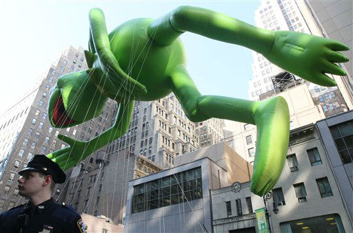 Christopher Poll, a member of the New York City Police Department Auxiliary Police, keeps watch as the Kermit the Frog balloon makes its way down New York&#39;s Sixth Avenue during the 85th Annual Macy&#39;s Thanksgiving Day Parade Thursday Nov. 24, 2011. &#40;AP Photo&#47;Tina Fineberg&#41; <span class=meta>(AP Photo&#47; Tina Fineberg)</span>