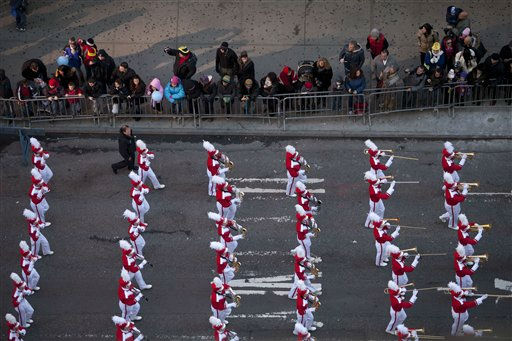"<div class=""meta ""><span class=""caption-text "">A marching band marches through Times Square during the Macy's Thanksgiving Day Parade in New York on Thursday, Nov. 24, 2011. The parade premiered in 1924, this is its 85th year. (AP Photo/Andrew Burton) (AP Photo/ Andrew Burton)</span></div>"