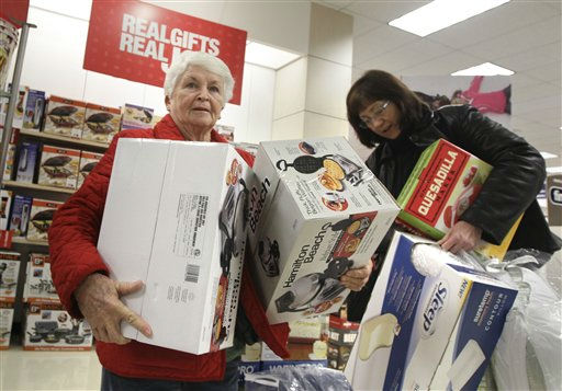 "<div class=""meta image-caption""><div class=""origin-logo origin-image ""><span></span></div><span class=""caption-text"">D'Lane Kight, left and another shopper carry small appliances at a North Little Rock, Ark., Sears store Friday, early Nov. 25, 2011. The American holiday shopping season began in earnest Friday as stores opened their doors at midnight _ a few hours earlier than they normally do on the most anticipated shopping day of the year. (AP Photo/Danny Johnston) (AP Photo/ Danny Johnston)</span></div>"