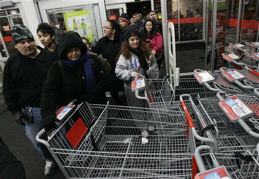 Unidentified shoppers rush into a Kmart in Chicago on Friday, Nov. 24, 2011. Black Friday began in earnest as stores opened their doors at midnight. Thousands of shoppers lined up at Macy&#39;s, Best Buy and other stores nationwide to buy everything from toys to tablets on Black Friday despite the economic downturn and some planned protests of the shopping holiday.&#40;AP Photo&#47;Nam Y. Huh&#41; <span class=meta>(AP Photo&#47; Nam Y. Huh)</span>