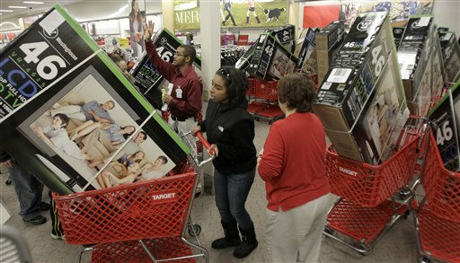 Early bird shoppers snatch up flat screen televisions at the Target store in Mayfield Hts., Ohio in the early hours of Friday, Nov. 25, 2011.   Black Friday began in earnest as Target, Abercrombie &amp; Fitch and other stores opened their doors at midnight.  &#40;AP Photo&#47;Amy Sancetta&#41; <span class=meta>(AP Photo&#47; Amy Sancetta)</span>