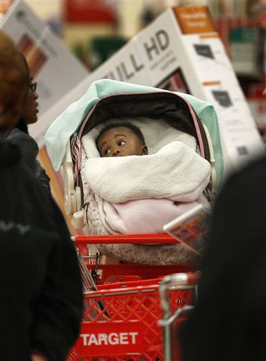 An infant in a shopping cart watches the bustling activity around her as early bird shoppers find bargains at the Target store in Mayfield Hts., Ohio in the early hours of Friday, Nov. 25, 2011.    Black Friday began in earnest as Target, Abercrombie &amp; Fitch and other stores opened their doors at midnight. &#40;AP Photo&#47;Amy Sancetta&#41; <span class=meta>(AP Photo&#47; Amy Sancetta)</span>