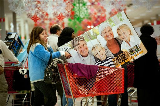 Stephanie Wajsman waits in line with other shoppers to checkout after getting a large screen television which was on sale at a Target store in Roswell, Ga., early Friday, Nov. 25, 2011.  Black Friday began in earnest as stores opened their doors at midnight.  &#40;AP Photo&#47;Rich Addicks&#41; <span class=meta>(AP Photo&#47; Rich Addicks)</span>