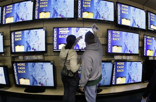 "<div class=""meta ""><span class=""caption-text "">Shoppers look at televisions displayed at a Best Buy store after a midnight opening on Friday, Nov. 25, 2011, in Brentwood, Tenn. Black Friday began in earnest as stores opened their doors at midnight. (AP Photo/Mark Humphrey) (AP Photo/ Mark Humphrey)</span></div>"