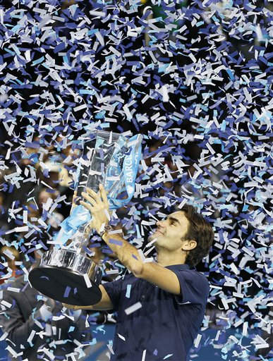 "<div class=""meta ""><span class=""caption-text "">Roger Federer of Switzerland holds up the winners trophy after he defeated Jo-Wilfried Tsonga of France in their singles final tennis match at the ATP World Tour Finals, in the O2 arena in London, Sunday, Nov.  27, 2011. (AP Photo/Kirsty Wigglesworth) (AP Photo/ Kirsty Wigglesworth)</span></div>"