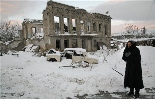An elderly Ossetian woman stands in front of the house destroyed during a Georgian assault in Tskhinvali, the regional capital of Georgia&#39;s breakaway province of South Ossetia, Sunday, Nov. 27, 2011. For the first time since Georgia and Russia fought a brief war over the control of the territory in 2008 Georgia&#39;s breakaway republic of South Ossetia is electing a new president in the second round of elections. &#40;AP Photo&#47;Musa Sadulayev&#41; <span class=meta>(AP Photo&#47; Musa Sadulayev)</span>
