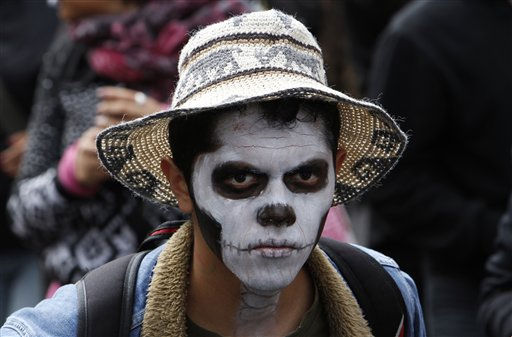A demonstrator looks on during a protest against violence in Mexico City, Sunday, Nov. 27, 2011. Demonstrators wore skull masks or painted their faces as skulls to symbolize the victims of violence in Mexico. Over 50,000 people have died since Mexican President Felipe Calderon launched his offensive against organized crime in 2006. &#40;AP Photo&#47;Marco Ugarte&#41; <span class=meta>(AP Photo&#47; Marco Ugarte)</span>