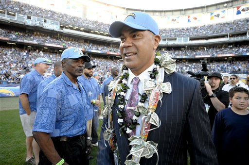 "<div class=""meta ""><span class=""caption-text "">FILE -In this Nov. 27, 2011, file photo, former San Diego Chargers great Junior Seau smiles during his induction into the Chargers Hall of Fame during a halftime ceremony of an NFL football game in San Diego. Police say Seau, a former NFL star, was found dead at his home in Oceanside, Calif., Wednesday, May 2, 2012, after responding to a shooting there. He was 43. (AP Photo/Denis Poroy, File) (AP Photo/ Denis Poroy)</span></div>"