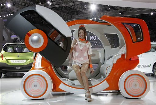 "<div class=""meta image-caption""><div class=""origin-logo origin-image ""><span></span></div><span class=""caption-text"">A model sits on Suzuki Motor Corp.,'s concept car ""Q-Concept"" during the press preview of Tokyo Motor Show in Tokyo, Wednesday, Nov. 30, 2011. The Tokyo Motor Show opens to the public this weekend. (AP Photo/Koji Sasahara) (AP Photo/ Koji Sasahara)</span></div>"