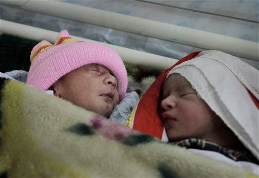 "<div class=""meta image-caption""><div class=""origin-logo origin-image ""><span></span></div><span class=""caption-text"">In this photo taken on Tuesday, Nov. 29, 2011, Afghan newly born babies are seen at the Malalai Maternity Hospital in Kabul, Afghanistan. Afghans are living longer, fewer infants are dying and more women are surviving childbirth because health care has dramatically improved around the country in the past decade, according to a national survey released Wednesday. (AP Photo/Musadeq Sadeq) (AP Photo/ Musadeq Sadeq)</span></div>"