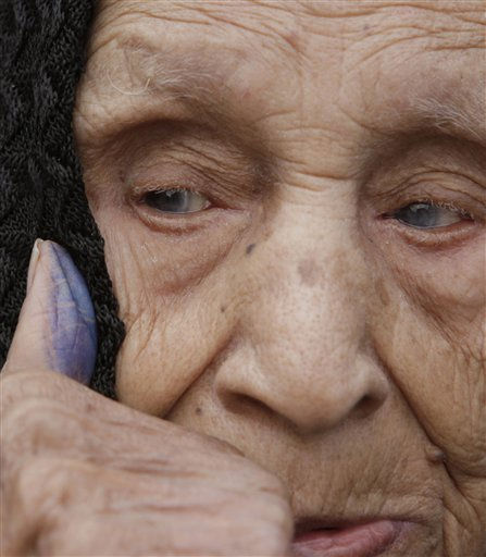 Fadila Mohammed, 90, holds up her inked thumb that shows she has voted at a polling station in Cairo, Egypt, Tuesday, Nov. 29, 2011. Polls opened Tuesday for a second day of voting in Egypt&#39;s landmark parliamentary elections, the first since Hosni Mubarak&#39;s ouster in a popular uprising earlier this year. &#40;AP Photo&#47;Amr Nabil&#41; <span class=meta>(AP Photo&#47; Amr Nabil)</span>