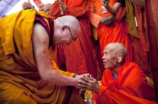 Tibetan spiritual leader the Dalai Lama, left, is greeted by a Thai Buddhist leader as he attends an all faith prayer meeting at the Gandhi Memorial in New Delhi, India, Wednesday, Nov. 30, 2011. The Dalai Lama is in the Indian capital attending the final session of the Global Buddhist Congregation. &#40;AP Photo&#47;Kevin Frayer&#41; <span class=meta>(AP Photo&#47; Kevin Frayer)</span>
