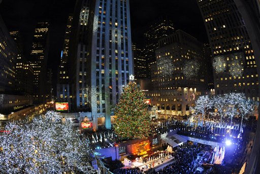 The 74-foot-tall Rockefeller Center Christmas Tree is lit using 30,000 energy efficient LED lights in the 79th annual lighting ceremony, Wednesday, Nov. 30, 2011 in New York.  &#40;AP Photo&#47;Henny Ray Abrams&#41; <span class=meta>(AP Photo&#47; Henny Ray Abrams)</span>