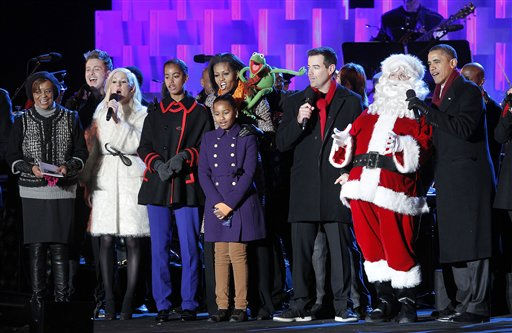 President Barack Obama, far right, and sings on stage with Santa Claus and members of his family after lighting the National Christmas Tree, at the Ellipse across from the White House in Washington, Thursday, Dec., 1, 2011. Also on stage from left to right are mother-in-law Marian Robinson, singers Rodney Atkins, Ellie Goulding, daughters Malia Obama, Sasha Obama, first lady Michelle Obama, Kermit the frog, and Carson Daly. &#40;AP Photo&#47;Pablo Martinez Monsivais&#41; <span class=meta>(AP Photo&#47; Pablo Martinez Monsivais)</span>