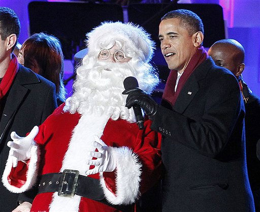 "<div class=""meta ""><span class=""caption-text "">President Barack Obama, far right, and sings on stage with Santa Claus after lighting the National Christmas Tree, at the Ellipse across from the White House in Washington, Thursday, Dec., 1, 2011. (AP Photo/Pablo Martinez Monsivais) (AP Photo/ Pablo Martinez Monsivais)</span></div>"
