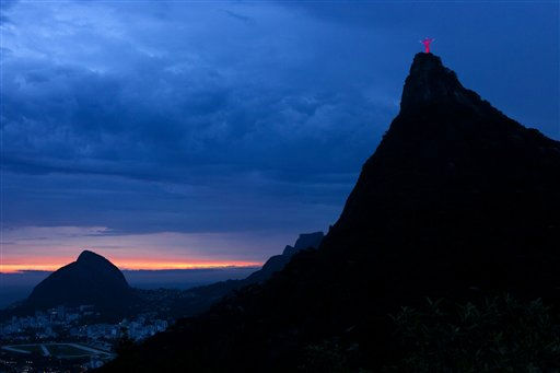 The Christ the Redeemer statue, top right, is lit in red light to commemorate the World AIDS Day in Rio de Janeiro, Brazil, Thursday, Dec. 1, 2011. Rio de Janeiro&#39;s city government illuminated several urban monuments in red as part of its actions to commemorate the World AIDS Day. &#40;AP Photo&#47;Victor R. Caivano&#41; <span class=meta>(AP Photo&#47; Victor R. Caivano)</span>