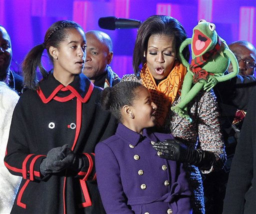 First lady Michelle Obama, with Kermit the frog, sings songs with daughters Malia, left, and Sasha Obama after the lighting of the National Christmas Tree at the Ellipse across from the White House in Washington, Thursday, Dec., 1, 2011. &#40;AP Photo&#47;Pablo Martinez Monsivais&#41; <span class=meta>(AP Photo&#47; Pablo Martinez Monsivais)</span>