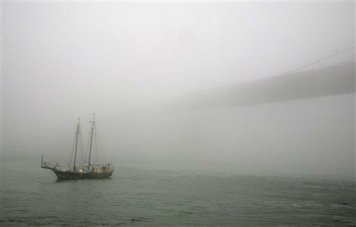 A tall ship passes through fog on the East River near the Brooklyn Bridge in New York Monday, Dec. 5, 2011. &#40;AP Photo&#47;Peter Morgan&#41; <span class=meta>(AP Photo&#47; Peter Morgan)</span>