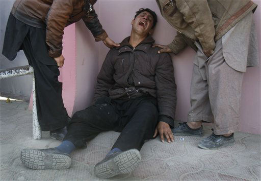 "<div class=""meta image-caption""><div class=""origin-logo origin-image ""><span></span></div><span class=""caption-text"">An Afghan man is comforted by relatives outside of a hospital in Kabul, Afghanistan, Tuesday, Dec. 6, 2011. A suicide bomber struck a crowd of Shiite worshippers marking a holy day Tuesday in the Afghan capital as scores of people were killed in an unprecedented wave of violence against the minority Islamic sect in Afghanistan. (AP Photo/Ahmad Jamshid) (AP Photo/ Ahmad Jamshid)</span></div>"