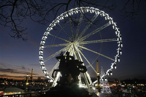 "<div class=""meta image-caption""><div class=""origin-logo origin-image ""><span></span></div><span class=""caption-text"">Night view of the ferris wheel set up for the Christmas period on the Place de la Concorde, in Paris, Wednesday Dec. 7, 2011. Visible at left is the Eiffel Tower.(AP Photo/Remy de la Mauviniere) (AP Photo/ Remy de la Mauviniere)</span></div>"