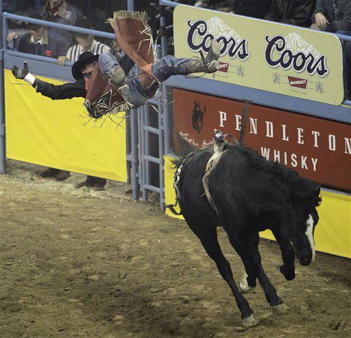 Matt Bright, of Azle, Ariz., is thrown from his horse during the bareback riding event in the eighth go-round of the National Finals Rodeo, Thursday, Dec. 8, 2011, in Las Vegas. &#40;AP Photo&#47;Julie Jacobson&#41; <span class=meta>(AP Photo&#47; Julie Jacobson)</span>