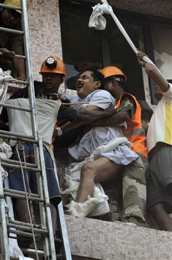 Fire officials rescue a patient as he cries in a pain, from the window of a nursing home after it caught fire in Kolkata, India, Friday, Dec. 9, 2011. A fire swept through a multistory nursing home in eastern India early Friday, trapping many elderly residents in the smoke-filled building, an official said. &#40;AP Photo&#47;Bikas Das&#41; <span class=meta>(AP Photo&#47; Bikas Das)</span>