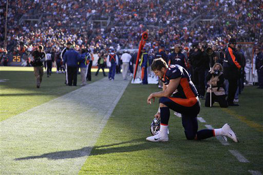 Denver Broncos quarterback Tim Tebow &#40;15&#41; prays in the end zone before the start of an NFL football game against the Chicago Bears, Sunday, Dec. 11, 2011, in Denver. &#40;AP Photo&#47;Julie Jacobson&#41; <span class=meta>(AP Photo&#47; Julie Jacobson)</span>