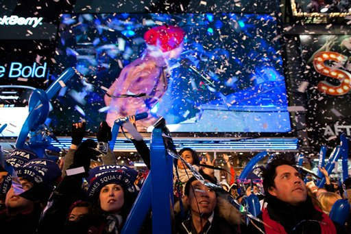 Revelers are showered in confetti in Times Square in anticipation of midnight on New Years Eve, Saturday, Dec. 31, 2011, in New York. Some revelers, wearing party hats and &#34;2012&#34; glasses, began camping out Saturday morning, as workers readied bags stuffed with hundreds of balloons and technicians put colored filters on klieg lights. &#40;AP Photo&#47;John Minchillo&#41; <span class=meta>(AP Photo&#47; John Minchillo)</span>