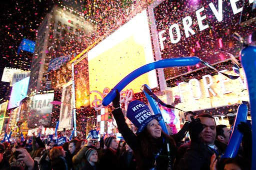 Revelers cheer at midnight in Times Square on New Years Eve, Saturday, Dec. 31, 2011, in New York. Some revelers, wearing party hats and &#34;2012&#34; glasses, began camping out Saturday morning, as workers readied bags stuffed with hundreds of balloons and technicians put colored filters on klieg lights. &#40;AP Photo&#47;John Minchillo&#41; <span class=meta>(AP Photo&#47; John Minchillo)</span>