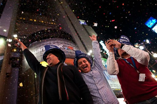 Revelers cheer at midnight in Times Square on New Years Eve, Sunday, Jan. 1, 2012, in New York. Some revelers, wearing party hats and &#34;2012&#34; glasses, began camping out Saturday morning, as workers readied bags stuffed with hundreds of balloons and technicians put colored filters on klieg lights. &#40;AP Photo&#47;John Minchillo&#41; <span class=meta>(AP Photo&#47; John Minchillo)</span>