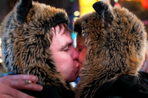 Revelers Steven MacWithey, 26, and Lauren MacWhithy, 24, of Las Vegas, share a kiss at midnight on New Years Eve in Times Square, Sunday, Jan. 1, 2012, in New York. Some revelers, wearing party hats and &#34;2012&#34; glasses, began camping out Saturday morning, as workers readied bags stuffed with hundreds of balloons and technicians put colored filters on klieg lights. &#40;AP Photo&#47;John Minchillo&#41; <span class=meta>(AP Photo&#47; John Minchillo)</span>