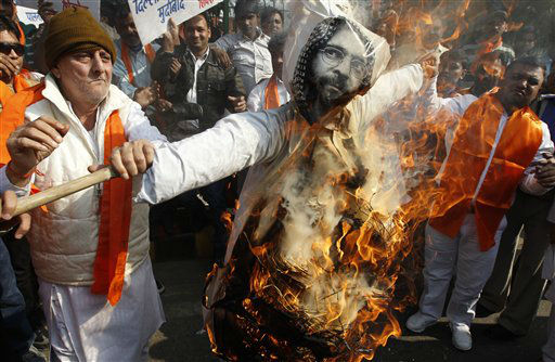 Supporters of the Hindu right wing party Shiv Sena burn an effigy of Mohammad Afzal Guru, the prime accused in the 2001 Parliament attack case, at a protest to mark the 10th anniversary of the attack in New Delhi, India, Tuesday, Dec. 13, 2011. Guru, a Kashmiri, confessed in TV interviews that he helped plot the attack that killed 14, including all five attackers. He has since denied any involvement and said he was tortured into confessing. &#40;AP Photo&#47;Mustafa Quraishi&#41; <span class=meta>(AP Photo&#47; Mustafa Quraishi)</span>