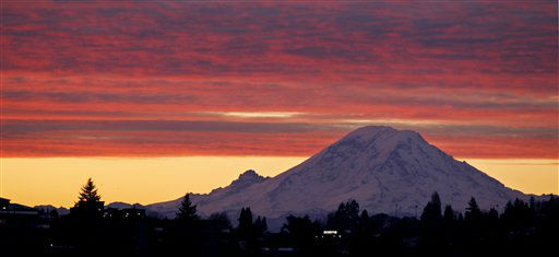 Mount Rainer, a 14,411-foot stratovolcano, is seen at dawn during a colorful sunrise Tuesday, Dec. 13, 2011, from Seattle, some 50 miles away. Generally clear skies are expected through Tuesday in the area, with an increasing chance of showers coming Wednesday, with highs in the low 40&#39;s through the week. &#40;AP Photo&#47;Elaine Thompson&#41; <span class=meta>(AP Photo&#47; Elaine Thompson)</span>