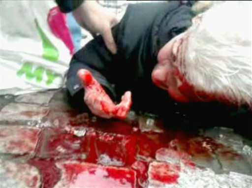 In this image taken from video, a man lays injured in the moments immediately following a grenade attack in the city center of Liege, Belgium, Tuesday, Dec. 13, 2011.  A man armed with hand grenades and guns opened fire in the crowded center of the Belgian city of Liege, Tuesday, Dec. 13, 2011, killing four people and wounding 75, an official said. This amateur video was filmed on a mobile phone by a man who was nearby when the grenades exploded. &#40;AP Photo&#47;Wissam Anabtawi, APTV&#41; TV OUT <span class=meta>(AP Photo&#47; Wissam Anabtawi)</span>