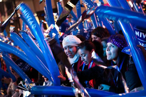 Revelers cheer and wave balloons behind police barricades in Times Square in anticipation of midnight on New Years Eve, Saturday, Dec. 31, 2011, in New York. Some revelers, wearing party hats and &#34;2012&#34; glasses, began camping out Saturday morning,as workers readied bags stuffed with hundreds of balloons and technicians put colored filters on klieg lights. &#40;AP Photo&#47;John Minchillo&#41; <span class=meta>(AP Photo&#47; John Minchillo)</span>