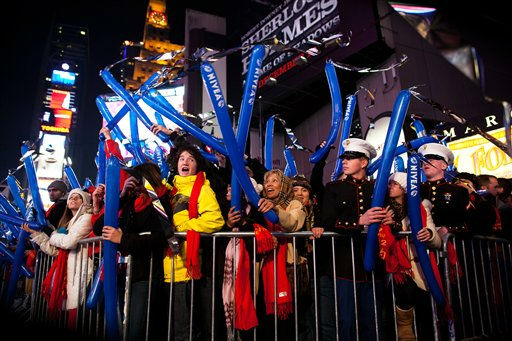 Revelers cheer behind police barricades in Times Square in anticipation of midnight on New Years Eve, Saturday, Dec. 31, 2011, in New York. Some revelers, wearing party hats and &#34;2012&#34; glasses, began camping out Saturday morning, as workers readied bags stuffed with hundreds of balloons and technicians put colored filters on klieg lights. &#40;AP Photo&#47;John Minchillo&#41; <span class=meta>(AP Photo&#47; John Minchillo)</span>