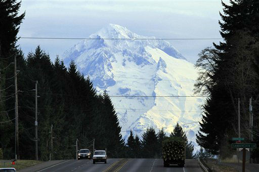 Oregon&#39;s Mount Hood looms over traffic on Highway 26 near Sandy, Ore., Wednesday, Dec. 14, 2011. There is a 100 percent chance of snow on the mountain Wednesday night with a chance of 3-7 inches of new snow accumulation according the the National Weather Service. &#40;AP Photo&#47;Don Ryan&#41; <span class=meta>(AP Photo&#47; Don Ryan)</span>
