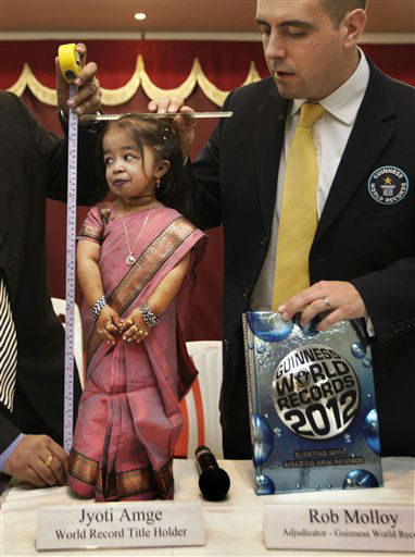 Dr. Manoj Pahukar of Wockhardt hospital, measures Jyoti Amge, 18, in Nagpur, India, Friday, Dec. 16, 2011. Amge is now eligible under the Guinness World Record guidelines for the &#34;Shortest Woman in the world&#34; title measuring 61.95 centimeters &#40;2 feet&#41;. &#40;AP Photo&#47;Manish Swarup&#41; <span class=meta>(AP Photo&#47; Manish Swarup)</span>