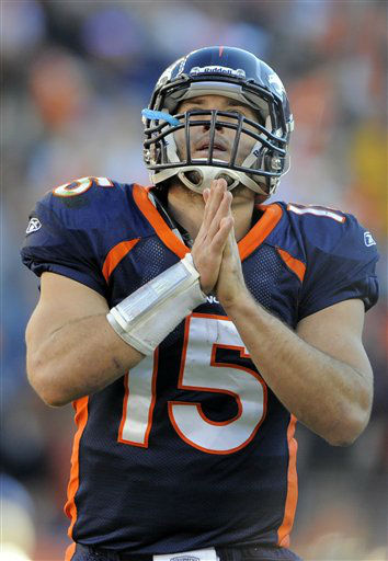 Denver Broncos quarterback Tim Tebow celebrates a touchdown during an NFL football game between the Denver Broncos and the New England Patriots in Denver, Sunday, Dec. 18, 2011. &#40;AP Photo&#47;Jack Dempsey&#41; <span class=meta>(AP Photo&#47; JACK DEMPSEY)</span>