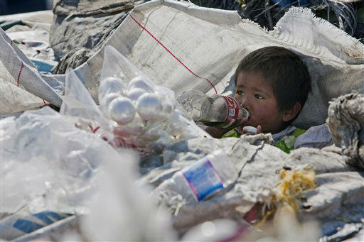 A boy drinks a soda among garbage at the landfill Bordo Poniente on the outskirts of Mexico City, Monday, Dec. 19, 2011. Mexico City will close one of the world&#39;s largest dumps by Dec. 31 and will instead turn the garbage from millions of people into reusable materials and energy, Mayor Marcelo Ebrard announced Monday. &#40;AP Photo&#47;Christian Palma&#41; <span class=meta>(AP Photo&#47; Christian Palma)</span>