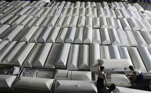 Philippine Navy personnel arrange coffins that will be shipped with drinking water, clothes and other relief goods to flood-stricken Cagayan De Oro and Iligan cities on board a Philippine Navy ship in Manila, Philippines on Tuesday Dec. 20, 2011. Nearly a thousand people died in massive flash floods when tropical storm Washi hit the country last week in one of the worst disasters to strike the region in decades. &#40;AP Photo&#47;Aaron Favila&#41; <span class=meta>(AP Photo&#47; Aaron Favila)</span>