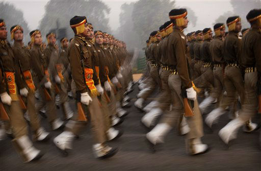 "<div class=""meta image-caption""><div class=""origin-logo origin-image ""><span></span></div><span class=""caption-text"">Indian soldiers march as they take part in a rehearsal on Rajpath for next month's Republic Day, on a cold and foggy morning in New Delhi, India, Wednesday, Dec. 21, 2011. Though India is famous for its brutally hot summers, temperatures fall sharply for a few weeks in December and January. (AP Photo/Kevin Frayer) (AP Photo/ Kevin Frayer)</span></div>"