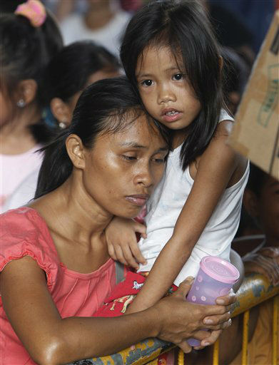 Affected residents queue up for relief goods being distributed at an evacuation center Thursday, Dec. 22, 2011, following Friday&#39;s flash flooding brought about by Tropical storm Washi in Cagayan De Oro city southern Philippines. Tens of thousands of residents continue to be housed in evacuation centers in the two cities of Cagayan de Oro and Iligan after Friday&#39;s flash floods that killed more than a thousand people and washed away their homes. &#40;AP Photo&#47;Bullit Marquez&#41; <span class=meta>(AP Photo&#47; Bullit Marquez)</span>