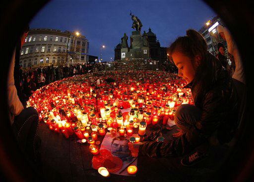 A girl lights a candle in remembrance of Czech statesman Vaclav Havel at the St. Wenceslas in Prague, Czech Republic, Thursday, Dec. 22, 2011. Havel, the dissident playwright who wove theater into politics to peacefully bring down communism in Czechoslovakia and become a hero of the epic struggle that ended the Cold War, died Sunday, Dec. 18, 2011 in Prague. He was 75. &#40;AP Photo&#47;Petr David Josek&#41; <span class=meta>(AP Photo&#47; Petr David Josek)</span>