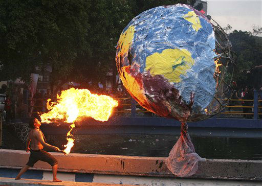 A fire eater performs in a street performance entitled &#34;Ritual Cyborg&#34; &#40;Cyborg Rites&#41; choreographed by Indonesian artist Sabil during Jakarta Biennale 2011 art festival in Jakarta, Indonesia, Friday, Dec. 23, 2011. &#40;AP Photo&#47;Dita Alangkara&#41; <span class=meta>(AP Photo&#47; Dita Alangkara)</span>