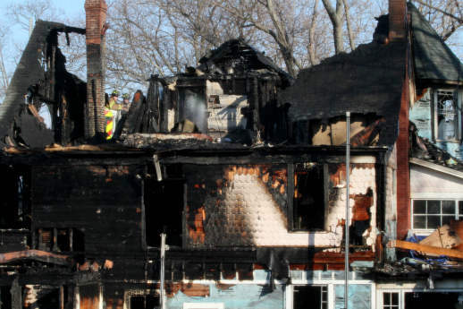 "<div class=""meta ""><span class=""caption-text "">Firefighters spray water on the roof of a house where an early morning fire left five people dead Sunday, Dec. 25, 2011, in Stamford, Conn. Officials said the fire, which was reported shortly before 5 a.m., killed two adults and three children. Two others escaped. Their names have not been released. (AP Photo/Tina Fineberg) (AP Photo/ Tina Fineberg)</span></div>"