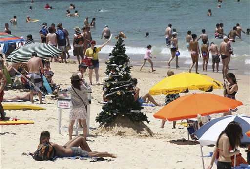"<div class=""meta image-caption""><div class=""origin-logo origin-image ""><span></span></div><span class=""caption-text"">A Christmas tree stands on Bondi Beach in Sydney, Australia, Sunday, Dec. 25, 2011. (AP Photo/Rob Griffith) (AP Photo/ Rob Griffith)</span></div>"