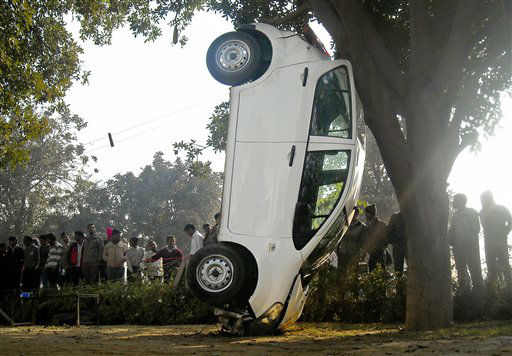 An car rests on its front end after a high speed collision with a tree in Gurgaon, India, Sunday, Dec. 25, 2011. The driver sustained minor injuries, according to a local newspaper report. &#40;AP Photo&#41; <span class=meta>(AP Photo&#47; Anonymous)</span>