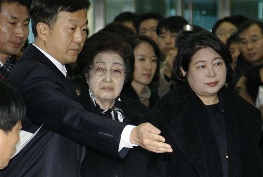 "<div class=""meta image-caption""><div class=""origin-logo origin-image ""><span></span></div><span class=""caption-text"">Lee Hee-ho, wearing glasses, widow of late former South Korean President Kim Dae-jung, and Hyundai Group chairwoman Hyun Jeong-eun, right, prepare to depart from the Inter-Korean Transit Terminal en route to North Korea from the border village of Paju in the demilitarized zone (DMZ), South Korea, Monday, Dec. 26, 2011. Lee and Hyun are part of a 18 person group allowed by South Korea to attend the Dec. 28 funeral of late North Korean leader Kim Jong Il in Pyongyang, North Korea. (AP Photo/Wally Santana) (AP Photo/ Wally Santana)</span></div>"