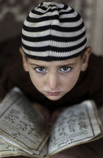 "<div class=""meta ""><span class=""caption-text "">Pakistani boy Suleiman Malik, 6, looks up while attending a daily class to learn how to recite verses of the Quran, in a mosque on the outskirts of Islamabad, Pakistan, Monday, Dec. 26, 2011. (AP Photo/Muhammed Muheisen) (AP Photo/ Muhammed Muheisen)</span></div>"